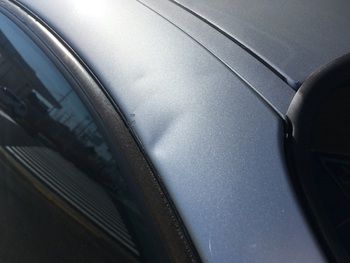 BMWの「1シリーズ」右フロントピラーのヘコミ / 和歌山の板金塗装・自動車修理はプロモワカヤマ